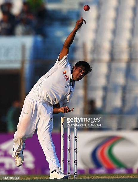 Bangladesh's Mehedi Hasan bowls during the first day of the first Test cricket match between Bangladesh and England at Zahur Ahmed Chowdhury Cricket...