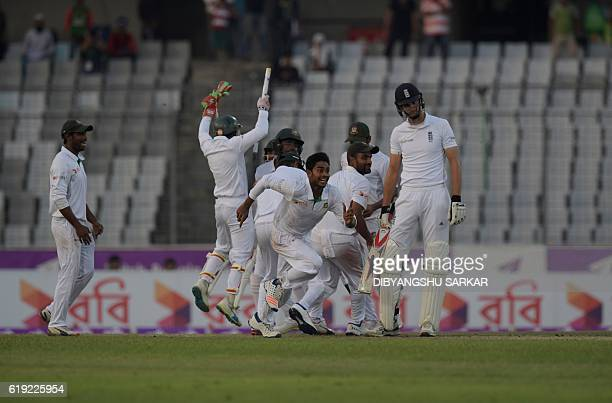 Bangladesh's Mehedi Hasan celebrates with teammates after winning on the third day of the second Test cricket match Bangladesh and England at the...