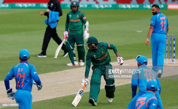 Bangladesh's Mehedi Hasan Miraz returns to his crease during the ICC Champions Trophy Warmup cricket match between India and Bangladesh at The Oval...