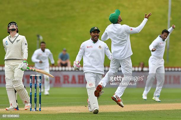 Bangladesh's Mehedi Hasan Siddique R celebrates catching New Zealand's Henry Nicholls with team mate Imrul Kayes during day four of the first...