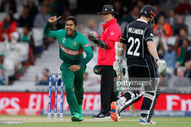 Bangladesh's Mehidy Hasan Miraz celebrates after taking the wicket of New Zealand's captain Kane Williamson during the 2019 Cricket World Cup group...