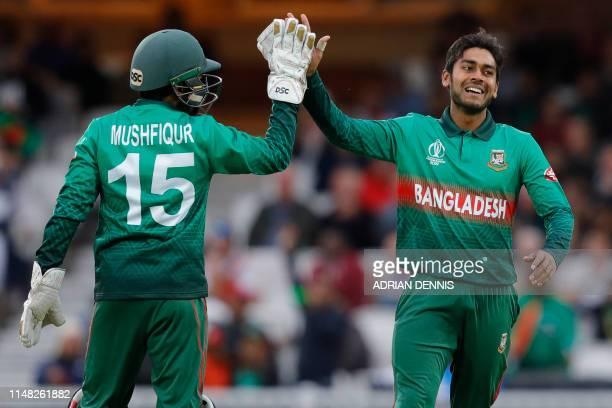 Bangladesh's Mehidy Hasan Miraz celebrates with Bangladesh's Mushfiqur Rahim after taking the wicket of New Zealand's captain Kane Williamson during...