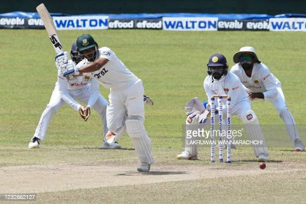 Bangladesh's Mehidy Hasan Miraz plays a shot as Sri Lanka's wicketkeeper Niroshan Dickwella during the final day of the second and final Test cricket...