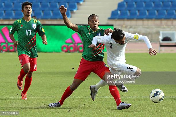 Bangladesh's midfielder Jamal Bhuyan vies with Jordan's Yousef Mazen alNaber during their World Cup 2018 Asian qualifying football match on March 24...