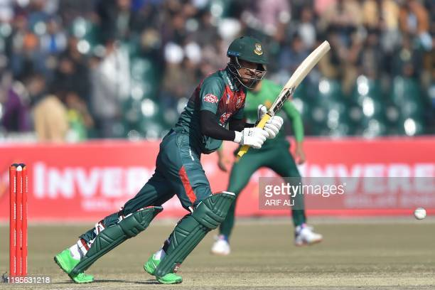 Bangladesh's Mohammad Naim plays a shot during the first T20 international cricket match of a threematch series between Pakistan and Bangladesh at...