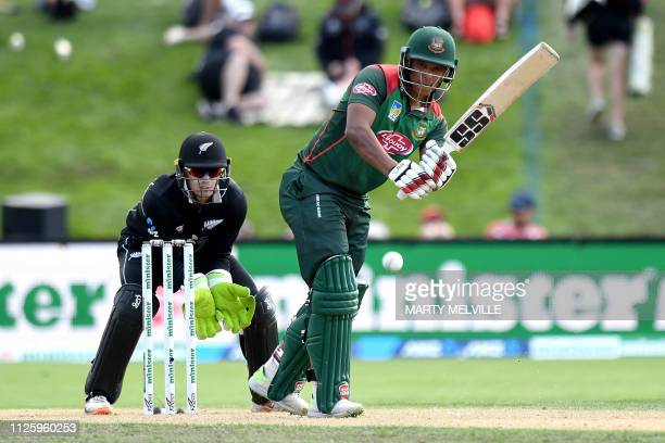 Bangladesh's Mohammad Saifuddin plays a shot during the third oneday international cricket match between New Zealand and Bangladesh at University...