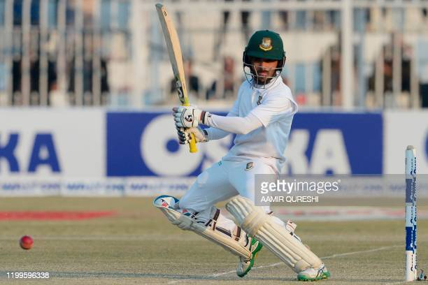 Bangladesh's Mominul Haque plays a shot during the third day of the first cricket Test match between Pakistan and Bangladesh at the Rawalpindi...