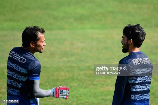 Bangladeshs Mominul Haque talks to his teammate Mushfiqur Rahim during a training session at the Sher-e-Bangla National Cricket Stadium in Dhaka in...