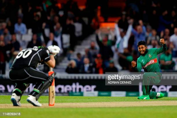 Bangladesh's Mosaddek Hossain celebrates after taking the wicket of New Zealand's James Neesham during the 2019 Cricket World Cup group stage match...