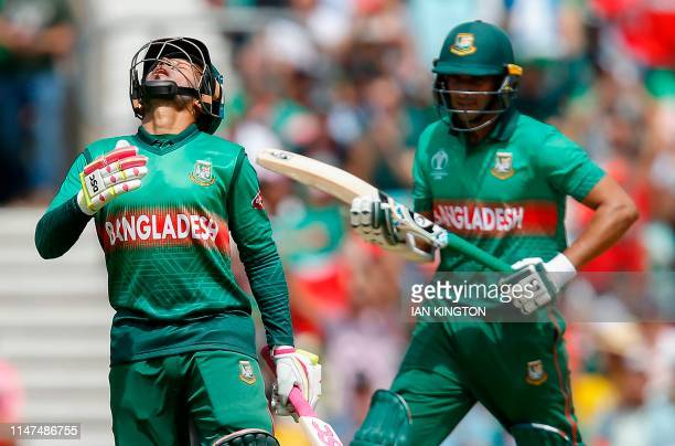 Bangladesh's Mushfiqur Rahim celebrates after scoring a halfcentury as teammate Shakib Al Hasan looks on during the 2019 Cricket World Cup group...