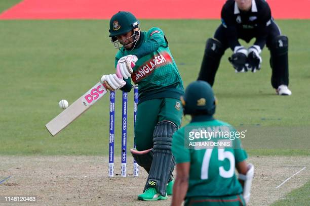 TOPSHOT Bangladesh's Mushfiqur Rahim hits a boundary during the 2019 Cricket World Cup group stage match between Bangladesh and New Zealand at The...