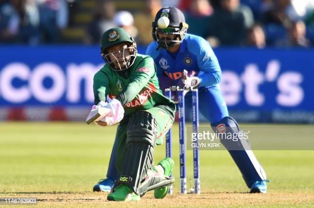 Bangladesh's Mushfiqur Rahim hits a six during the 2019 Cricket World Cup warm up match between Bangladesh v India at Sophia Gardens stadium in...