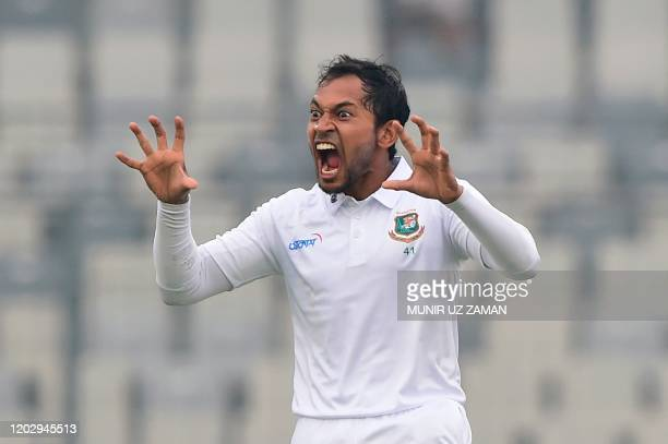 Bangladesh's Mushfiqur Rahim reacts after scoring a double century during the third day of a Test cricket match between Bangladesh and Zimbabwe at...
