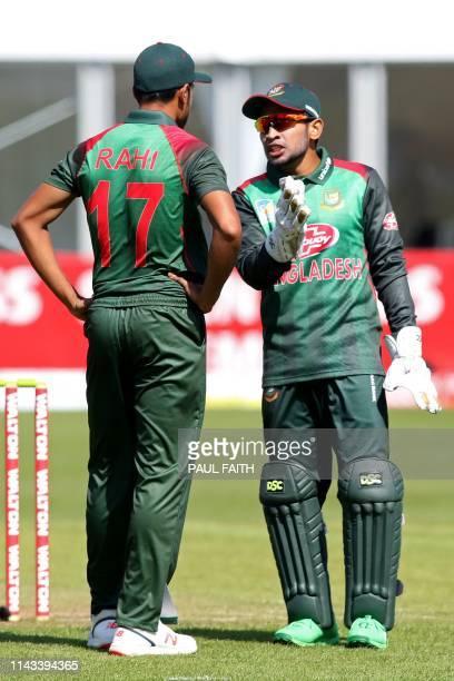 Bangladesh's Mushfiqur Rahim speaks with Bangladesh's Abu Jayed Rahi during the TriNation Series one day international between Bangladesh and West...