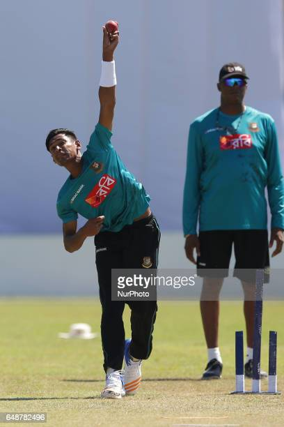Bangladesh's Mustafizur Rahman balls during a practice session ahead of the 1st Test Match at the Galle International Cricket Stadium in Galle on...
