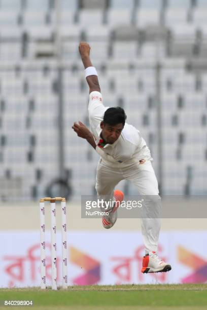 Bangladesh's Mustafizur Rahman bowls against Australia during day two of the First Test match between Bangladesh and Australia at Shere Bangla...