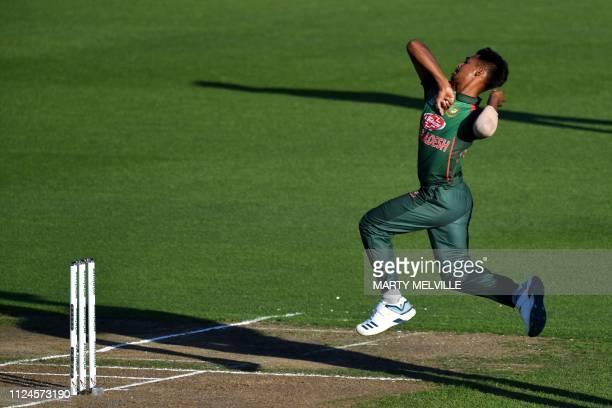 Bangladesh's Mustafizur Rahman bowls during the first oneday international cricket match between New Zealand and Bangladesh in Napier on February 13...