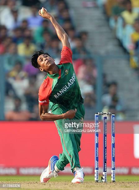 Bangladesh's Mustafizur Rahman bowls during the World T20 cricket tournament match between Bangladesh and New Zealand at The Eden Gardens Cricket...