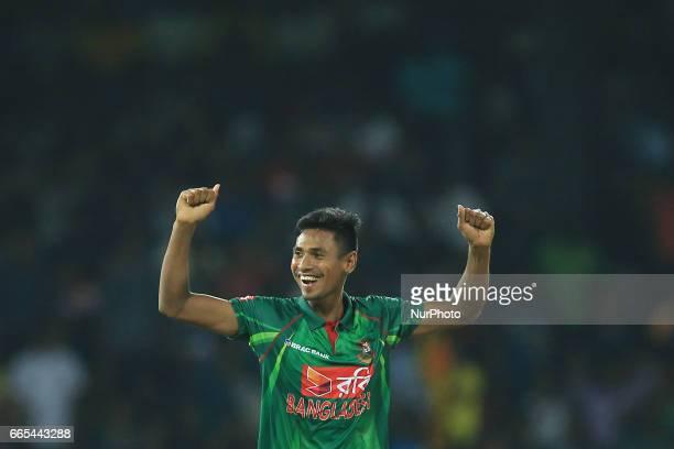 Bangladesh's Mustafizur Rahman celebrates Sri Lanka's Chamara Kapugedera is dismissed during the 2nd and final T20 International cricket match...