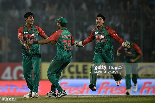 Bangladesh's Mustafizur Rahman celebrates with teammates after the dismissal of Sri Lanka's Thisara Perera during the Asia Cup T20 cricket tournament...