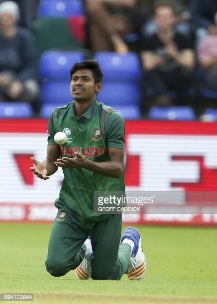 Bangladesh's Mustafizur Rahman makes the catch to take the wicket of New Zealand's Ross Taylor during the ICC Champions Trophy match between New...