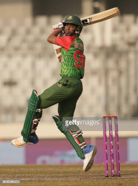 Bangladesh's Mustafizur Rahman plays a shot during the fifth One Day International match in the TriNations Series between Bangladesh and Zimbabwe at...