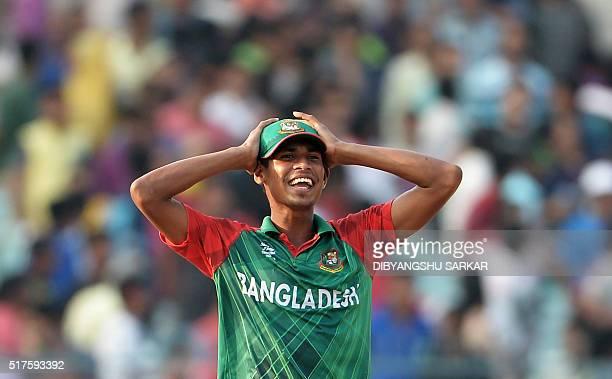 Bangladesh's Mustafizur Rahman reacts during the World T20 cricket tournament match between Bangladesh and New Zealand at The Eden Gardens Cricket...