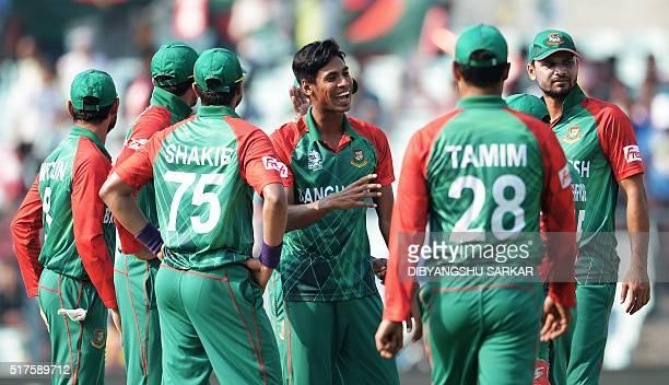 Bangladesh's Mustafizur Rahmancelebrates with teammates after the dismissal of New Zealand's Henry Nicholls during the World T20 cricket tournament...