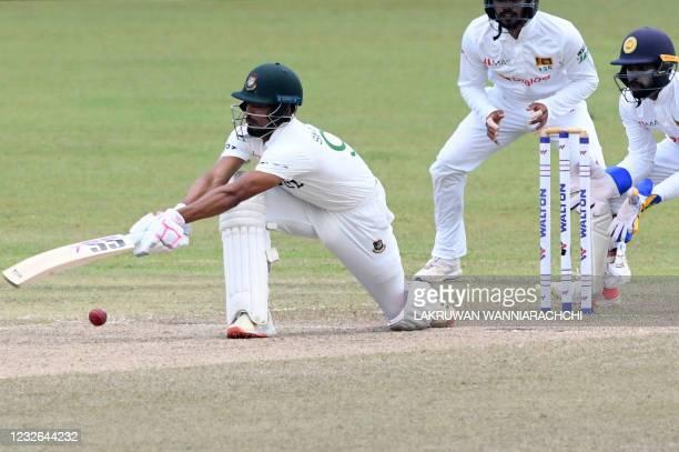 Bangladesh's Najmul Hossain Shanto plays a shot as Sri Lanka's wicketkeeper Niroshan Dickwella and Dhananjaya de Silva watch during the fourth day of...