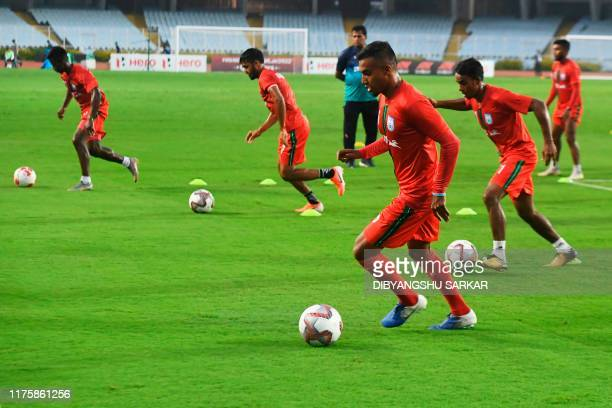 Bangladesh's national football team captain Jamal Bhuyan takes part in a training session with teammates ahead of their World Cup 2022 and 2023 AFC...