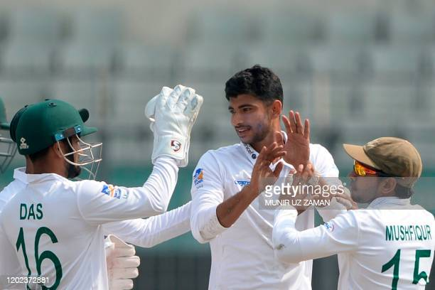 Bangladesh's Nayeem Hasan celebrates with teammates after the dismissal of the Zimbabwe's Prince Masvaure during the first day of the first Test...