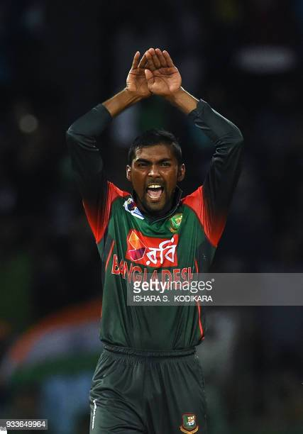 Bangladesh's Nazmul Islam celebrates after he dismissed India's Lokesh Rahul during the final Nidahas Twenty20 TriSeries international cricket match...