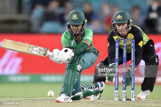 Bangladesh's Nigar Sultana Joty plays a sweep shot as Australia wicketkeeper Alyssa Healy looks on during the Twenty20 women's World Cup cricket...