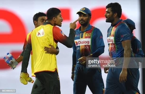 Bangladesh's Nurul Hasan exchanges words with Sri Lanka's skipper Thisara Perera during the sixth Twenty20 international cricket match between...