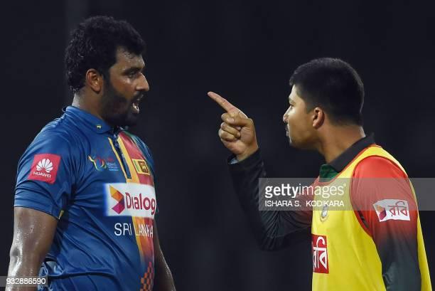 Bangladesh's Nurul Hasan speaks with Sri Lanka's Thisara Perera during the sixth Twenty20 international cricket match between Bangladesh and Sri...