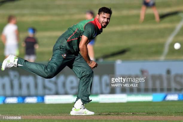Bangladesh's paceman Mashrafe Mortaza bowls during the first oneday international cricket match between New Zealand and Bangladesh in Napier on...