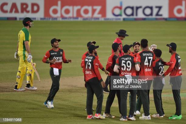 Bangladesh's players celebrate after the dismissal of Australia's Moises Henriques during third Twenty20 international cricket match between...
