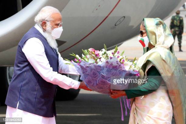 Bangladesh's Prime Minister Sheikh Hasina greets her Indian counterpart Prime Minister Narendra Modi at the Hazrat Shahjalal International Airport in...