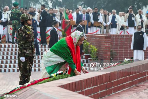 Bangladesh's Prime Minister Sheikh Hasina lays a wreath at the national memorial of the 1971 Bangladesh independence war's martyrs to mark the...
