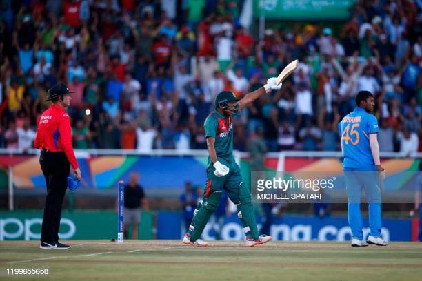 Bangladesh's Rakibul Hasan celebrates after scoring the winning runs as India's Atharva Ankolekar and umpire Sam Nogajski looks on at during the ICC...