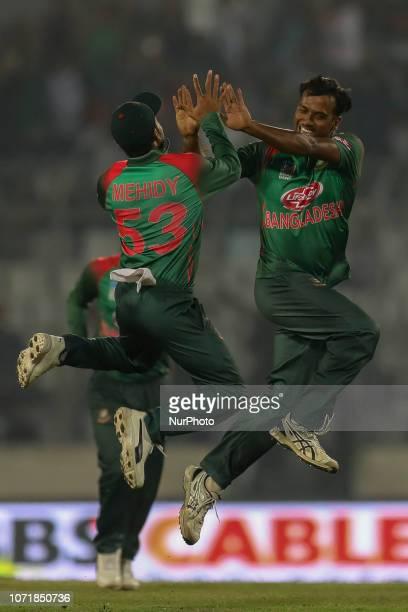 Bangladesh's Rubel Hossain celebrate with Mehedi Miraz after the dismissal of West Indies batsman Darren Bravo during the second ODI match between...