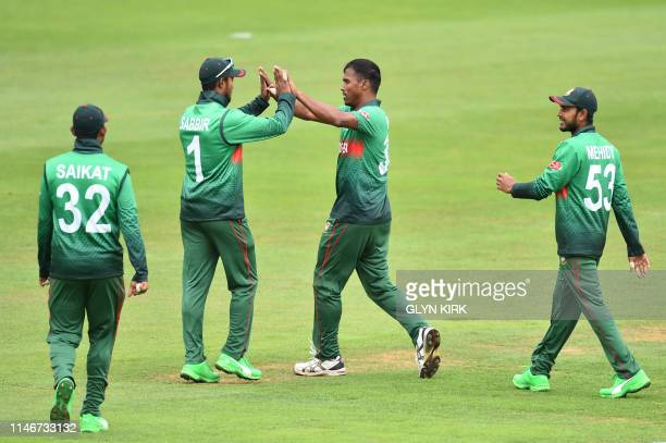 Bangladesh's Sabbir Rahman and Bangladesh's Rubel Hossain celebrate the dismissal of India's Vijay Shankar for 2 during the 2019 Cricket World Cup...
