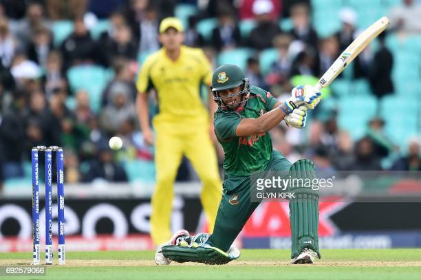 Bangladesh's Sabbir Rahman plays a shot that resulted to him losing his wicket for 8 runs to a catch by Australia's Steven Smith during the ICC...