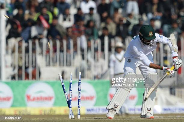TOPSHOT Bangladesh's Saif Hassan is bowled out by Pakistan's bowler Naseem Shah unseen during the third day of the first cricket Test match between...