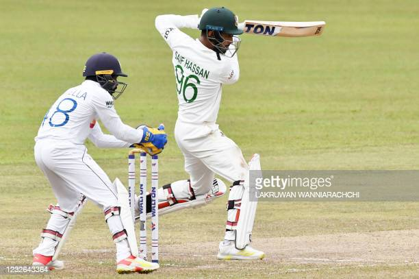 Bangladesh's Saif Hassan plays a shot as Sri Lanka's wicketkeeper Niroshan Dickwella watches during the fourth day of the second and final Test...
