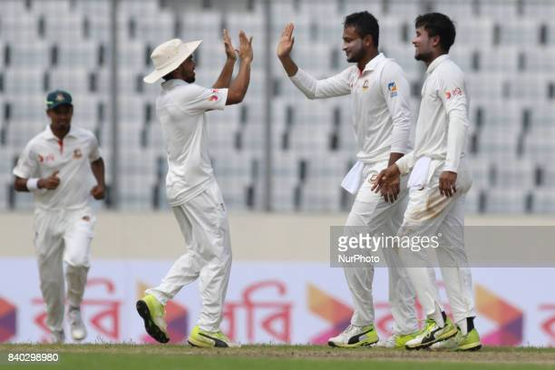 Bangladesh's Sakib Al Hasan center celebrates with his teammates Sabbir Rahman right after the dismissal of Australia's Glenn Maxwell during day two...