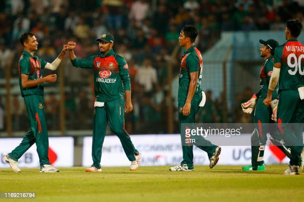 Bangladesh's Shafiul Islam celebrates with his teamamtes after a dismissal during the fourth Twenty20 international match of a trination cricket...
