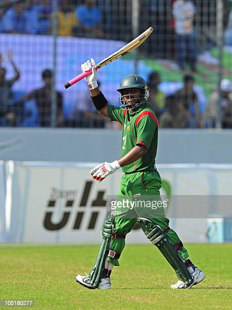 Bangladesh's Shahriar Nafees acknowledges the crowd as he leave the pitch after after being dismissal by New Zealand's Nathan McCullum during the...