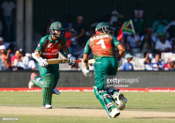 Bangladesh's Shakib Al Hasan and Sabbir Rahman cross for a single during their ODI OneDay International match against South Africa at the Buffalo...