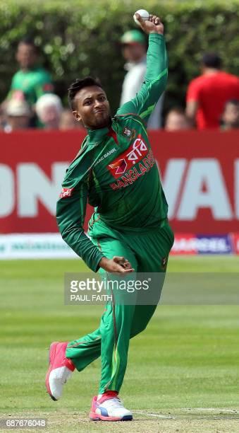 Bangladesh's Shakib Al Hasan bowls a ball during the TriSeries one day international cricket match between Bangladesh and New Zealand at Clontarf...